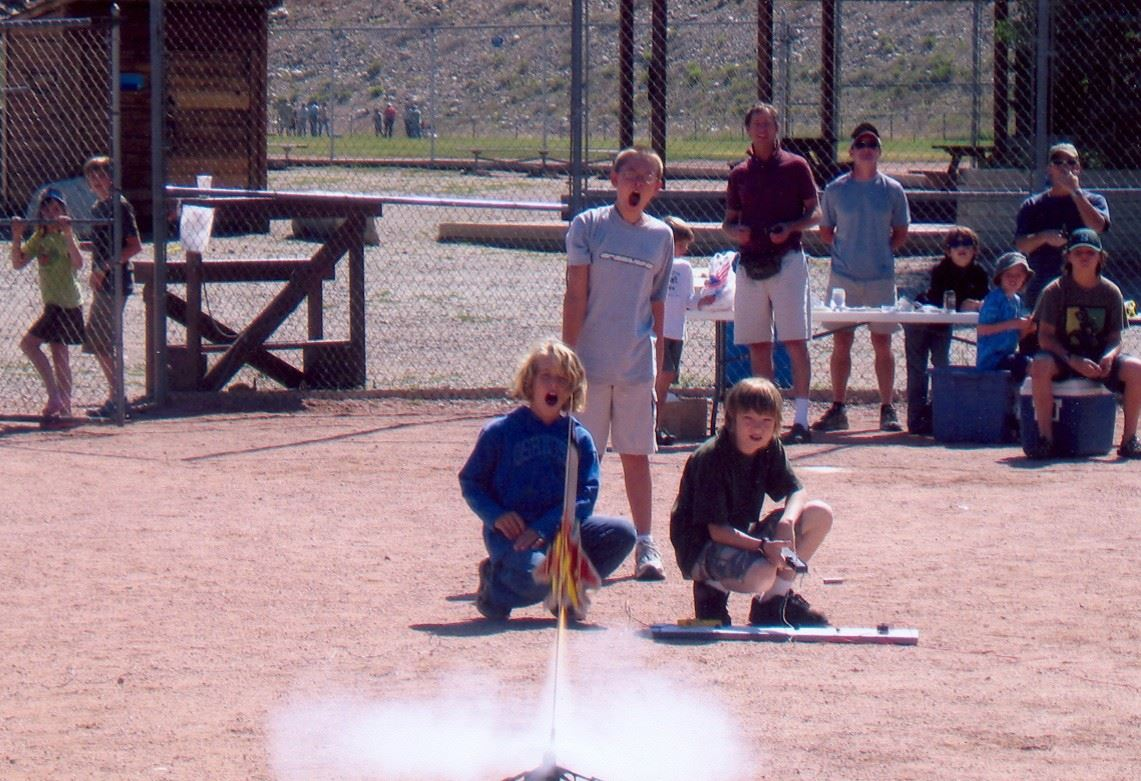 4-H kids launching a rocket outdoors