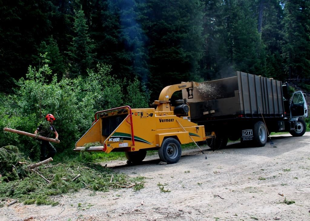 Photo of a crew operating a chipper.