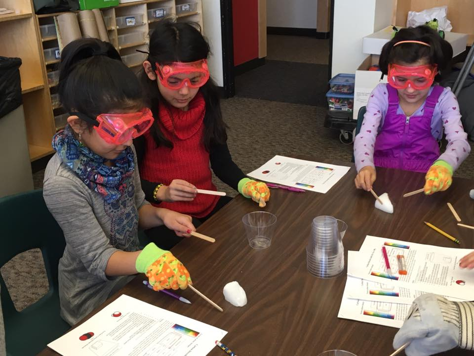 Children participating in a 4-H STEM project at school