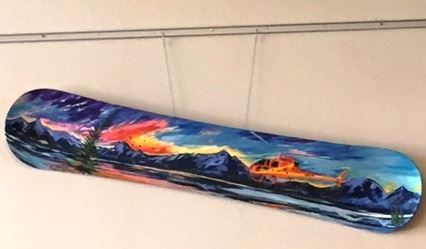 Photo of a rescue scene painted on a snowboard