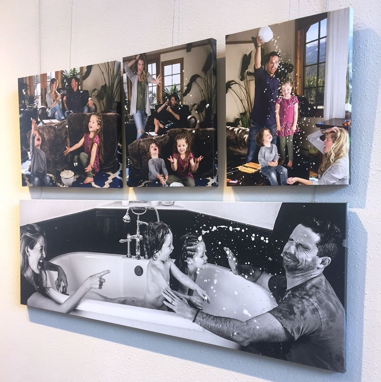 Photo of photographs of a family playing at home.