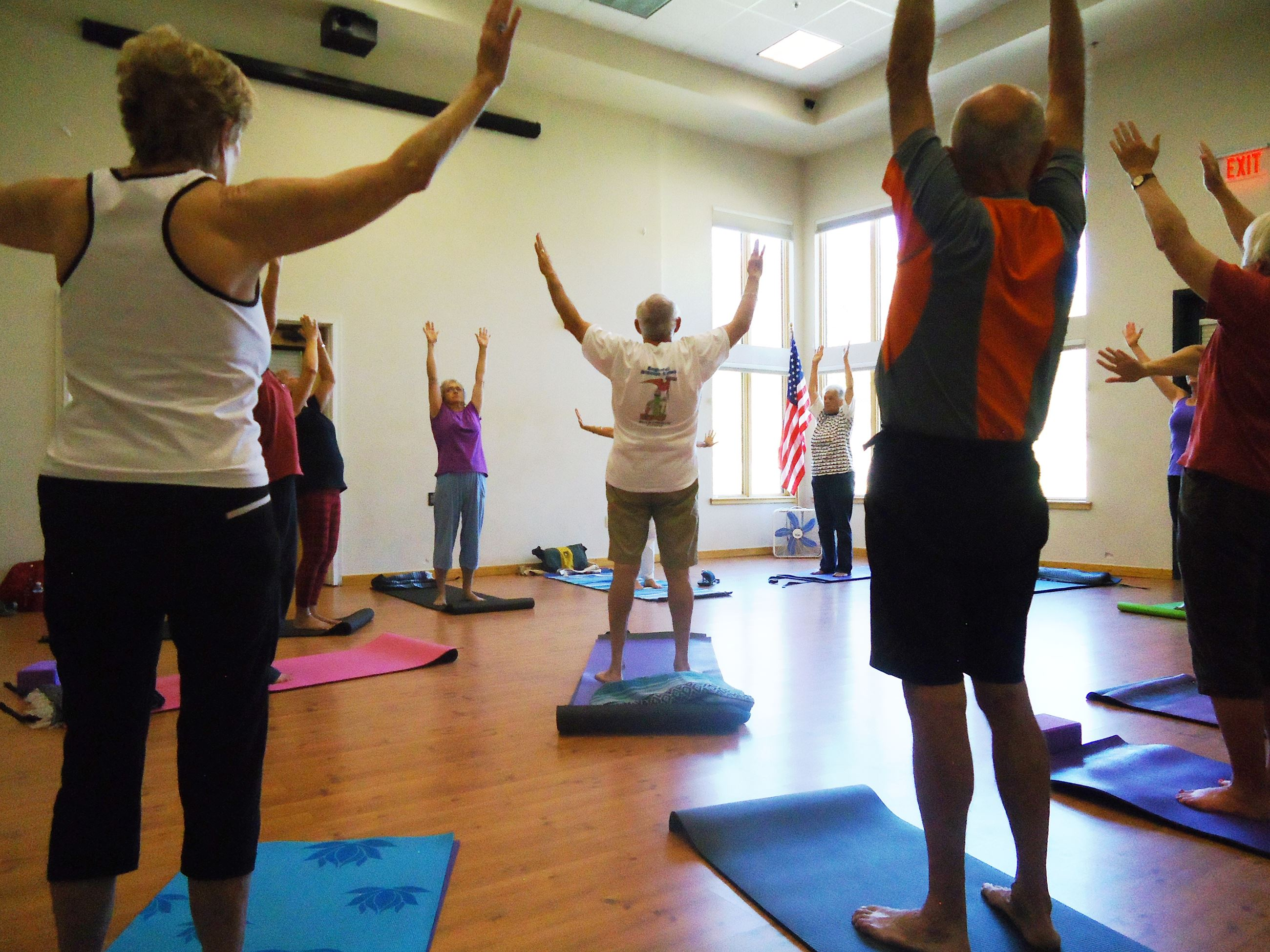 Photo of seniors in a yoga class.