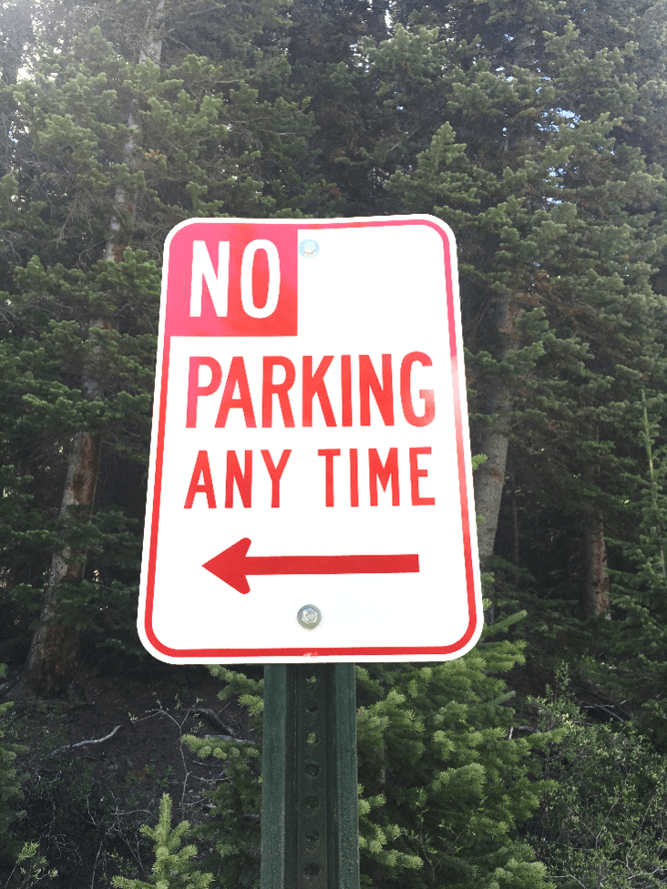 Photo of a no parking sign.