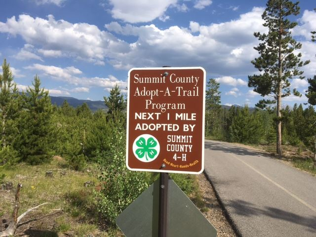 Summit County 4-H Adopt-a-Trail sign on rec path