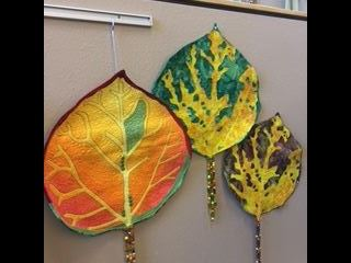 Fabric sculptures of aspen leaves.