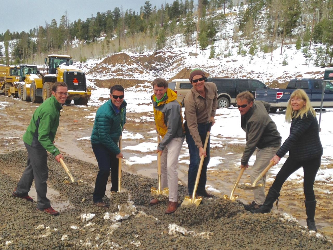 Six people breaking ground with ceremonial shovels.