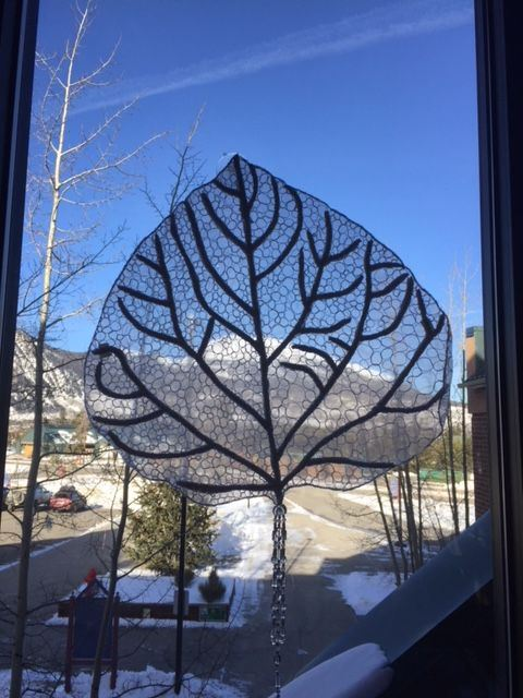 Sculpture depicting the outline & veins of an aspen leaf.