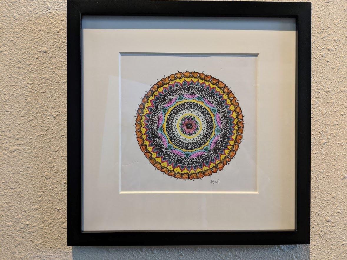 Framed drawing of colorful mandala