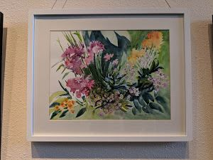 Framed watercolor painting of a bunch of flowers