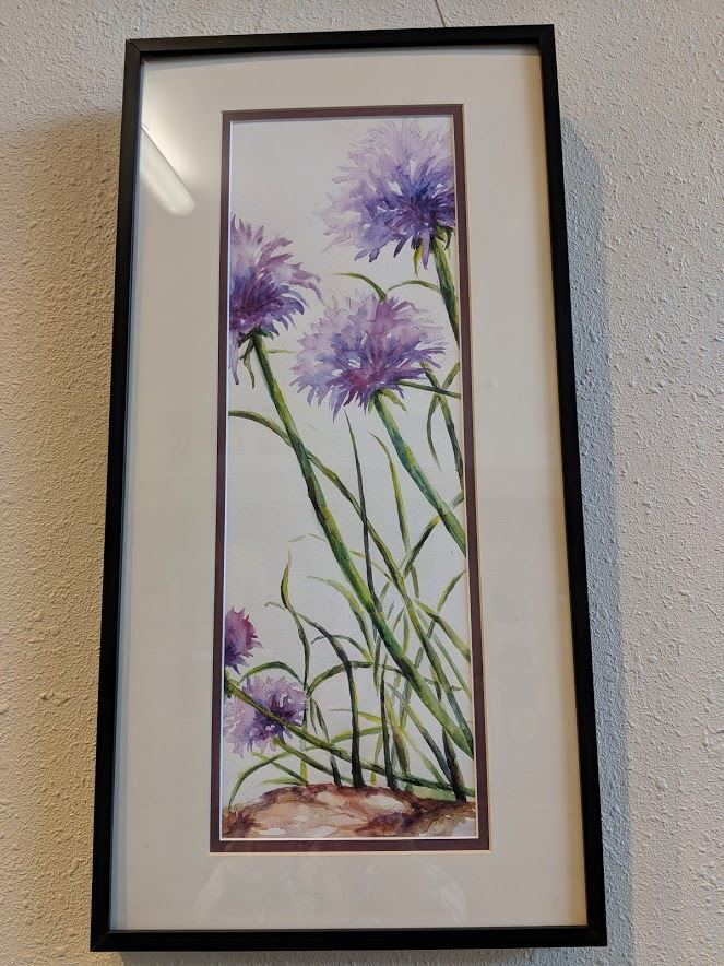 Framed watercolor painting of purple flowers