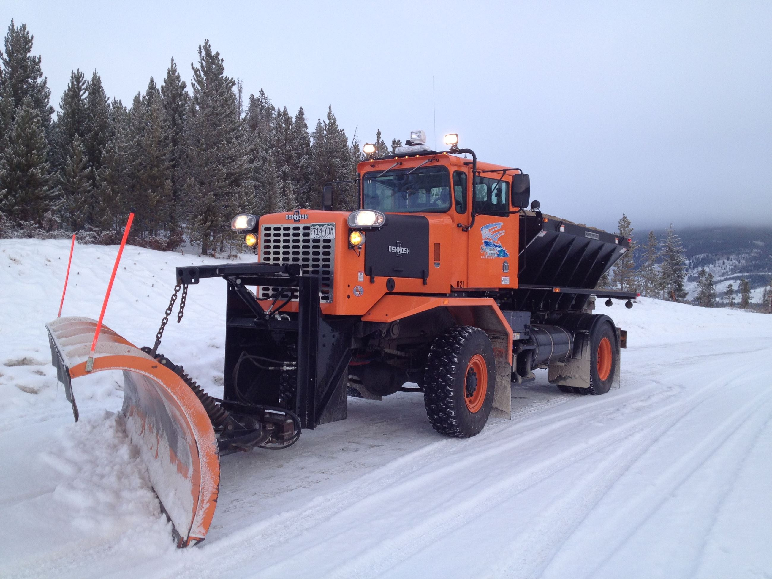A Summit County plow clears a road of snow.