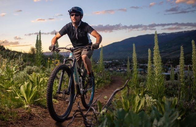 A biker rides the newly constructed Cortina Trail, photo by Tripp Fay