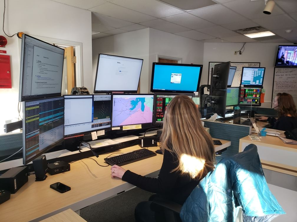 Dispatchers take calls at the Summit County 911 center.