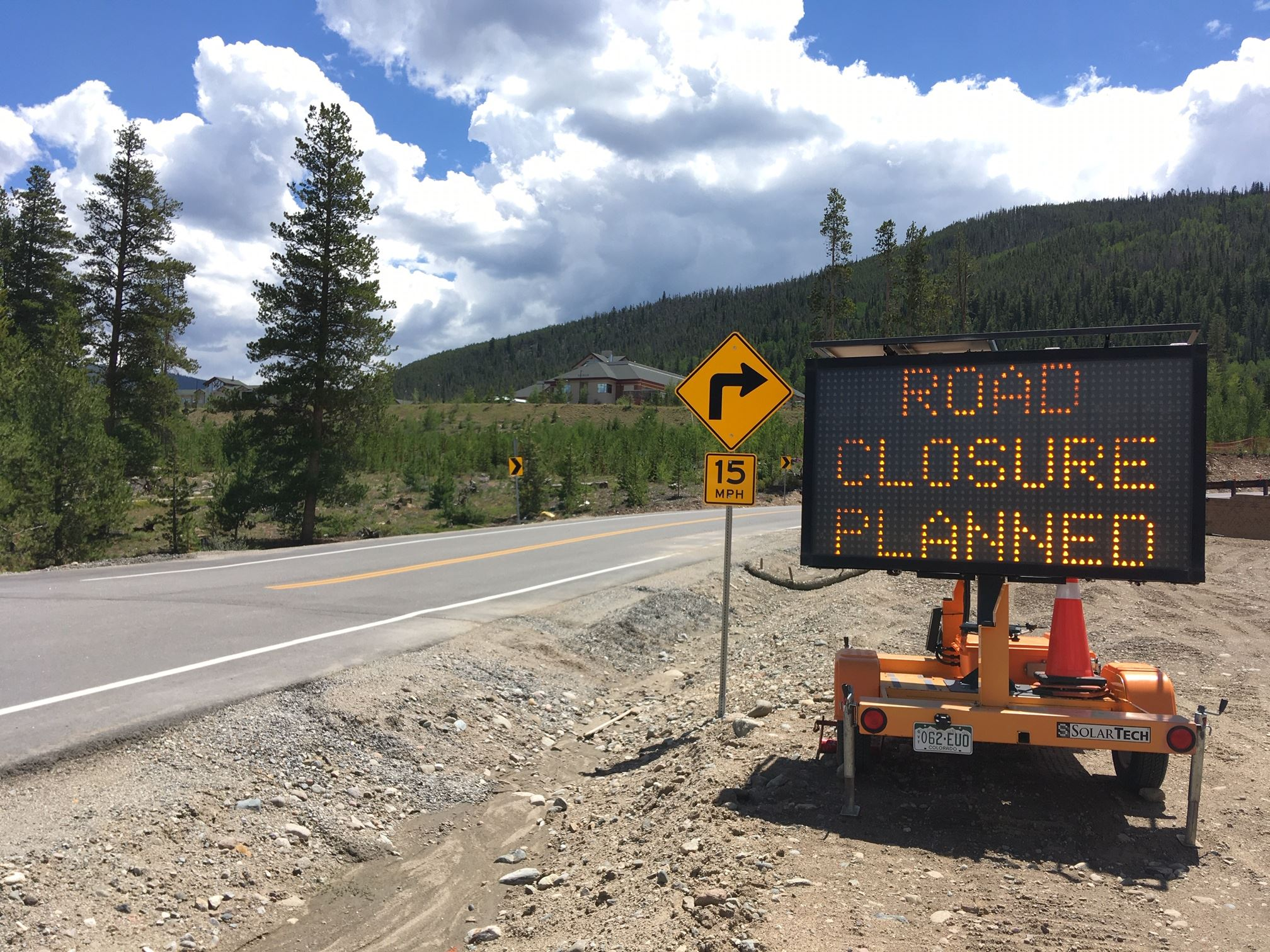 An electronic message board on Peak One Drive indicates an upcoming closure.