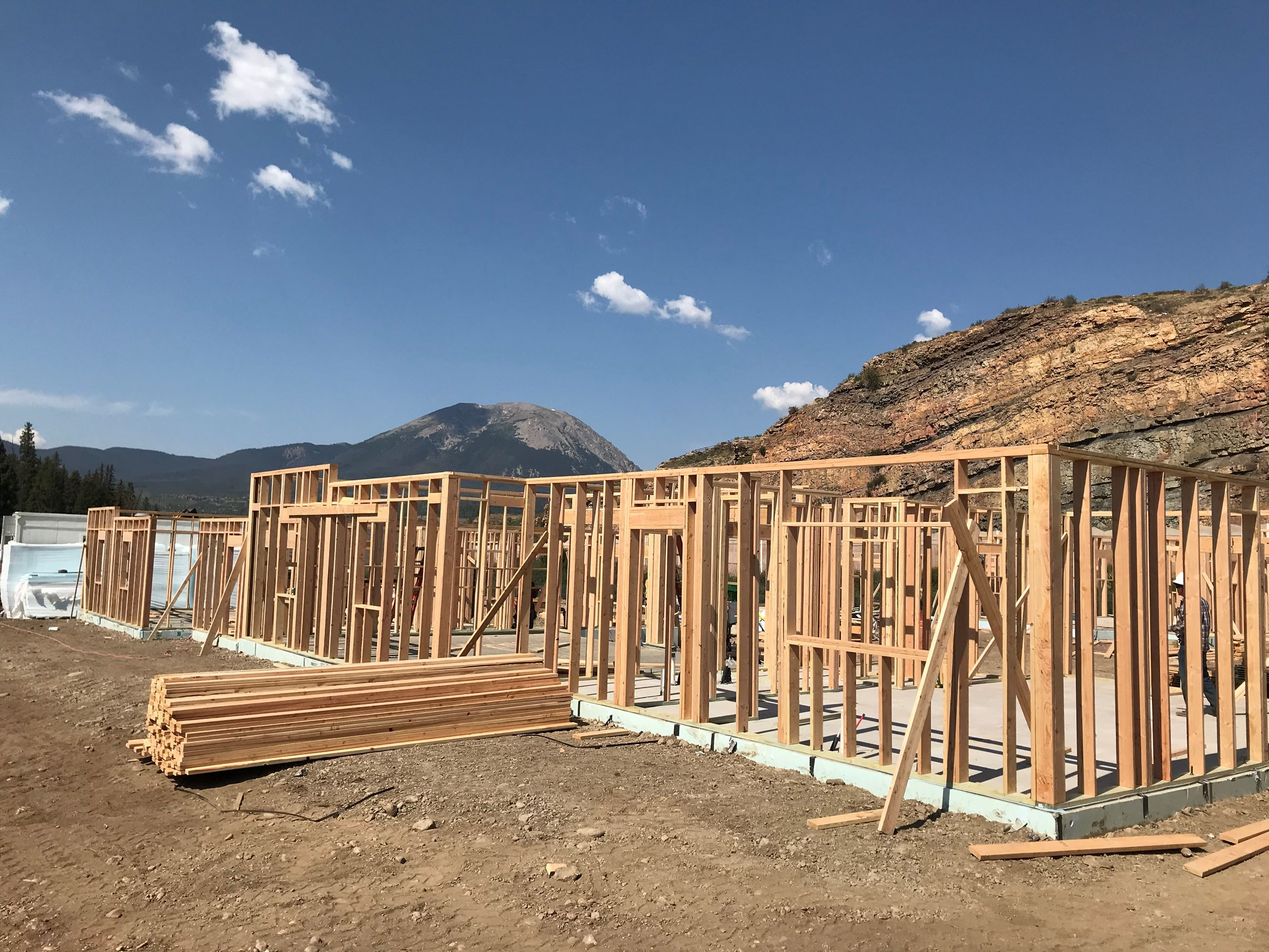 Photo of Dillon Valley Vistas Townhomes being framed, with mountains in background