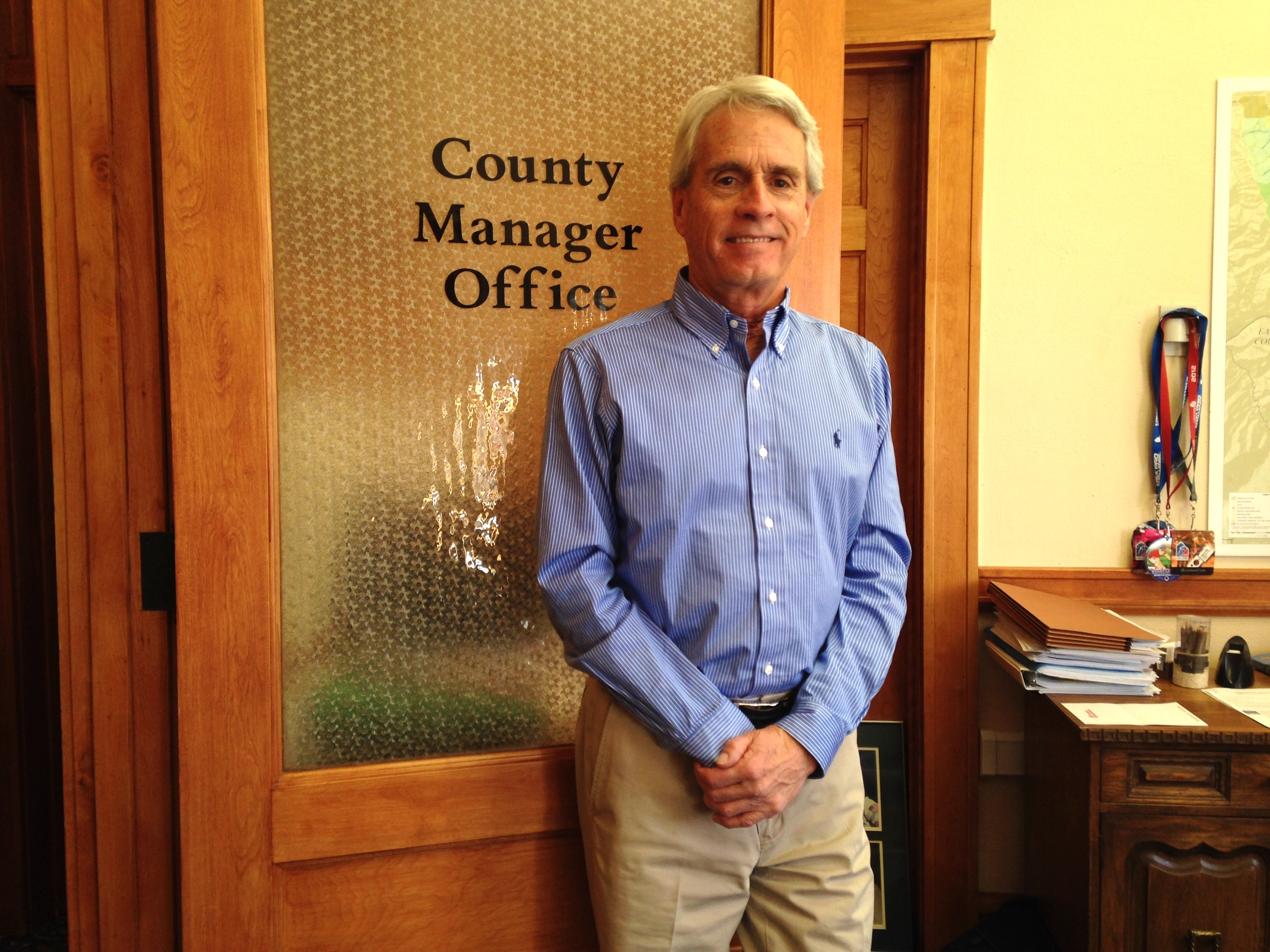 Photo of Gary Martinez standing in front of the County Manager's Office.