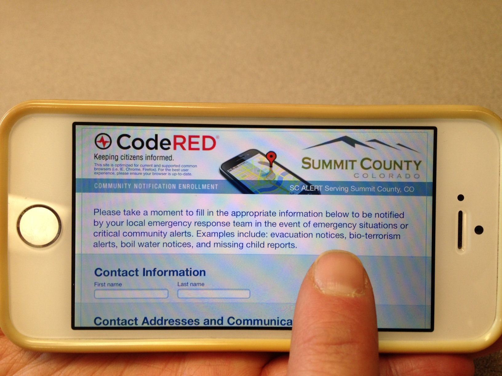 Photo of a smartphone on the SC Alert login screen.