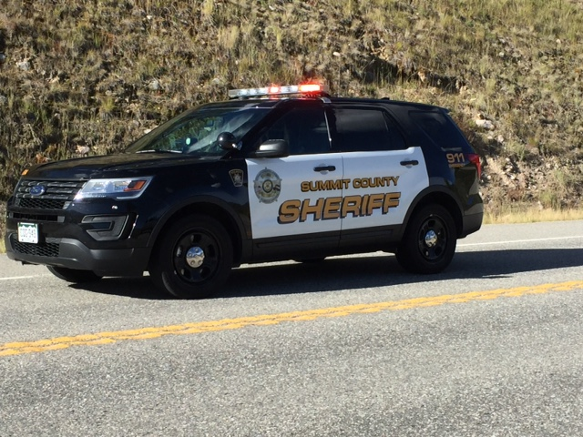 Photo of a Summit County Sheriff's Office patrol vehicle, with lights on.