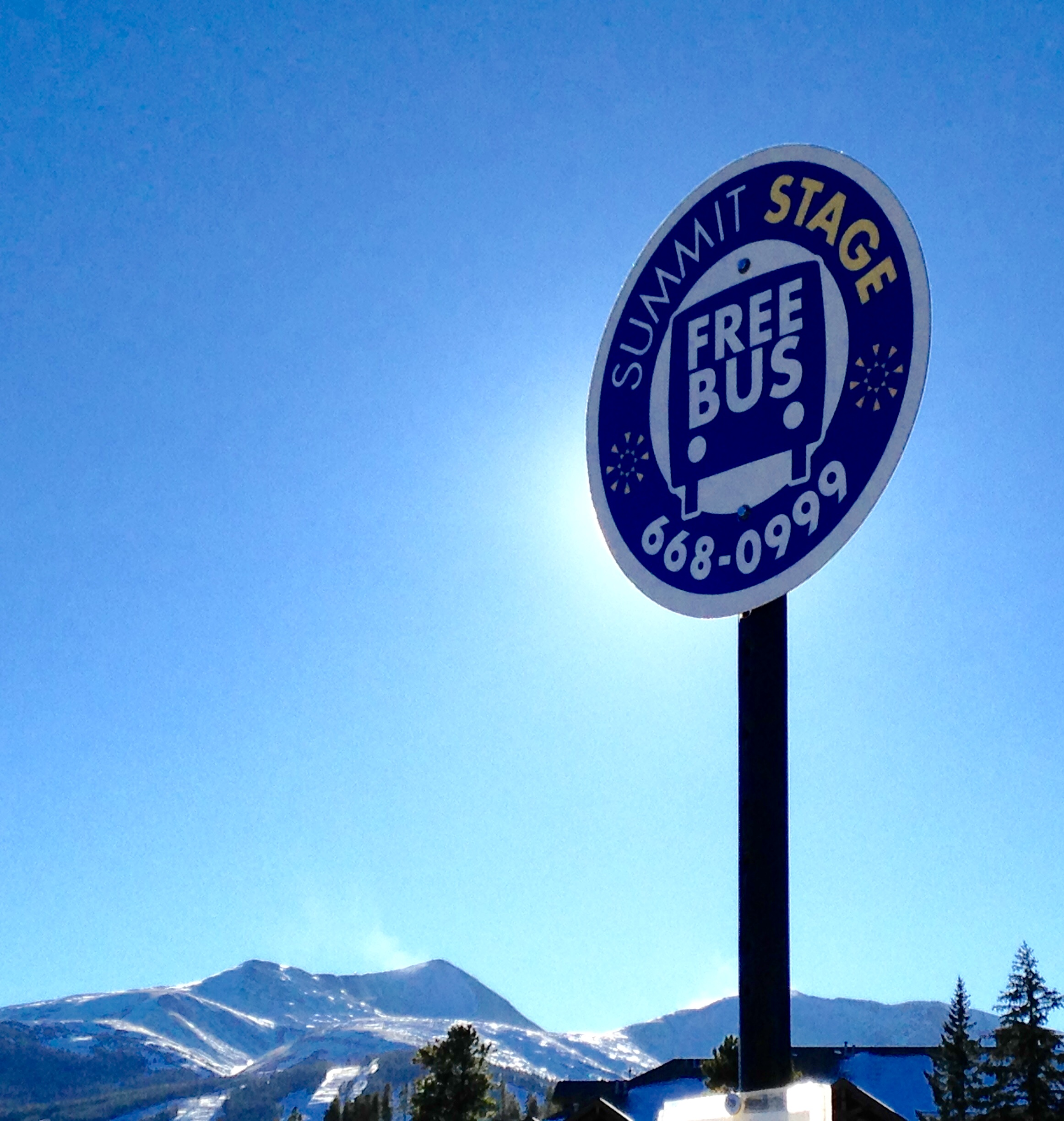 Photo of a Summit Stage sign at a bus stop.