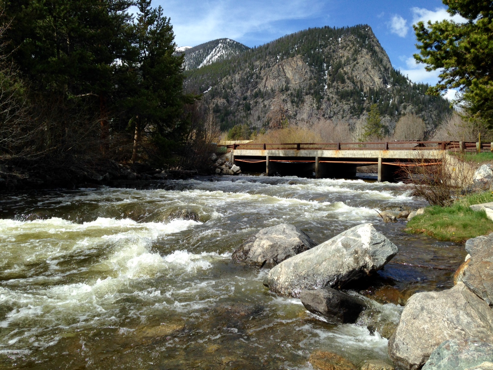Photo of whitewater in Tenmile Creek below a bridge.