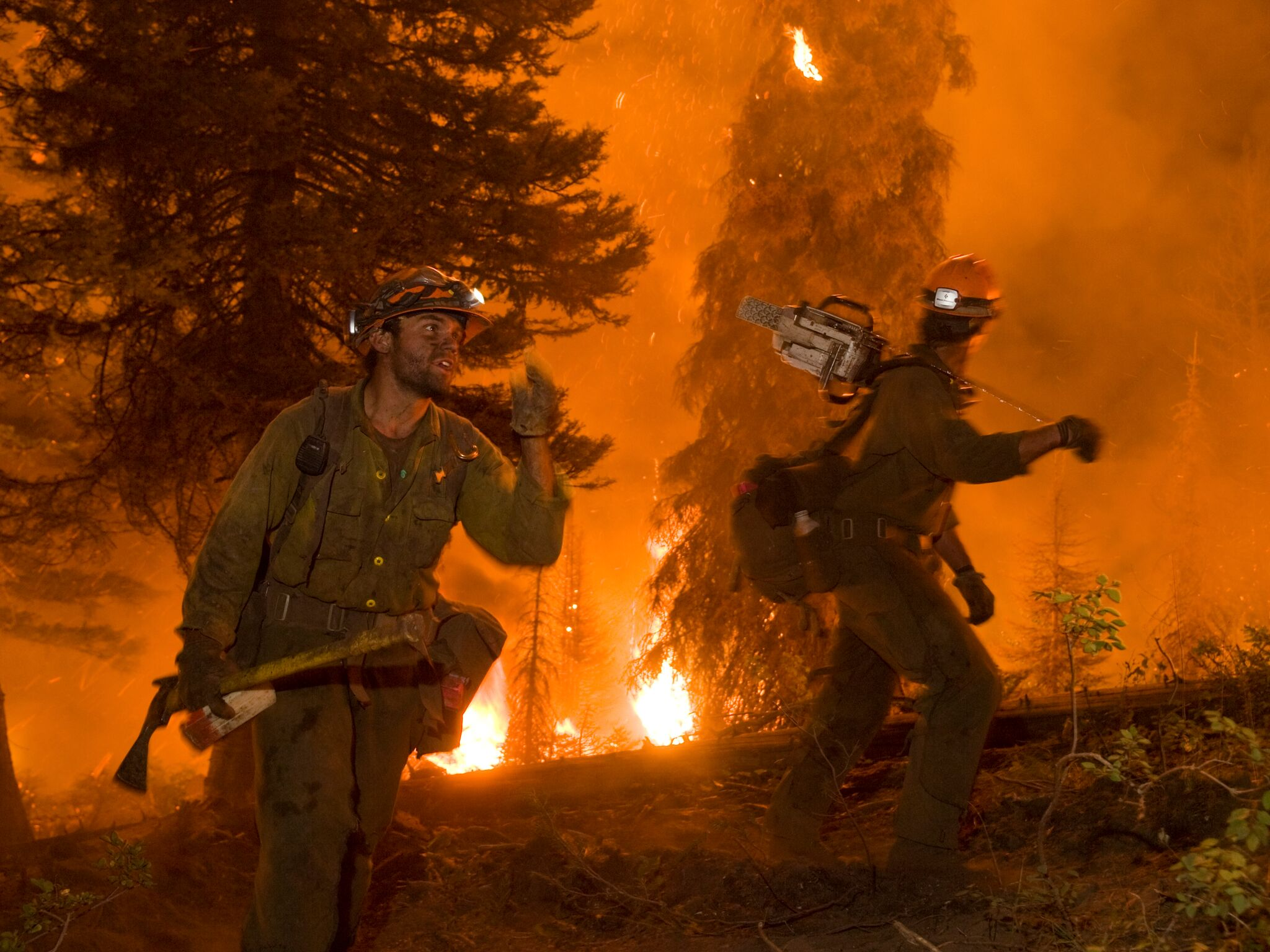 Photo of two firefighters at a wildfire.