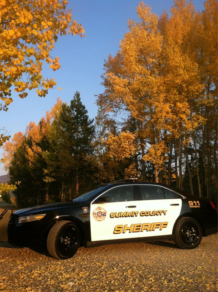 Sheriff's Office car in fall aspens